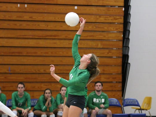 Fort Myers captain Alayna Ryan hits the ball during Thursday night's Class 7A regional semifinals at Barron Collier.