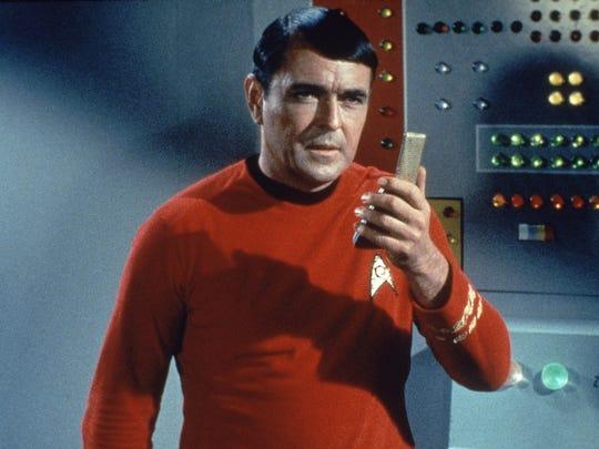 James Doohan as Lieutenant Commander Montgomery uses