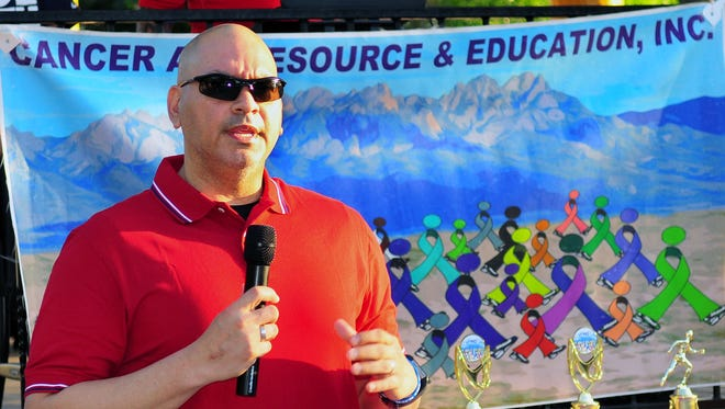 Richard Chavez talks about his son's battle with cancer prior to the start of the Race for CARE held Sunday morning at the Plaza in Mesilla.