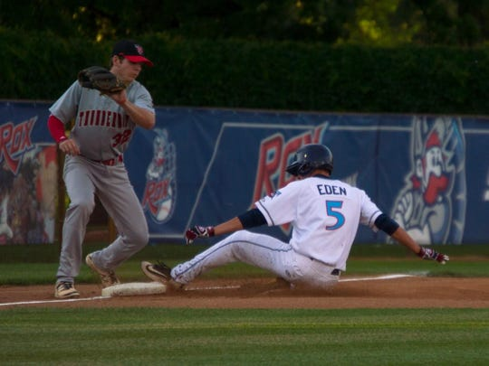 Cameron Eden (5) of the St. Cloud Rox slides in safely before Thunder Bay Thunder Cats third baseman Brendan Dougherty could apply a tag.