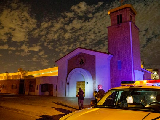 Phoenix police officers investigate at Mater Misericordiae (Mother of Mercy) Mission, where the Rev. Kenneth Walker, 28, was shot and killed and the Rev. Joseph Terra, 56, was badly beaten on June 11, 2014.