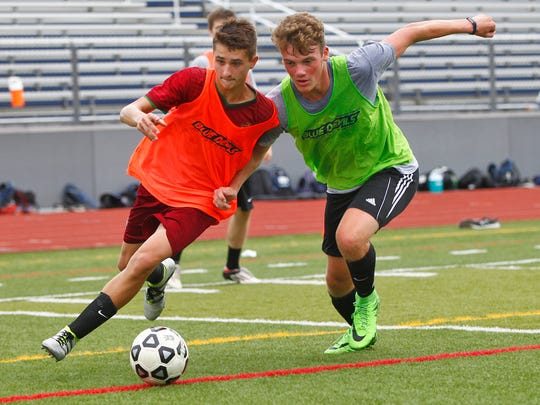 Vladimir Laurinovich, left, and Ethan Stocum battle for the ball during Chenango Forks practice  on Monday.