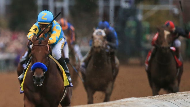 Victor Espinoza and American Pharaoh led early in their win the Breeders' Cup Classic Saturday at Keeneland.