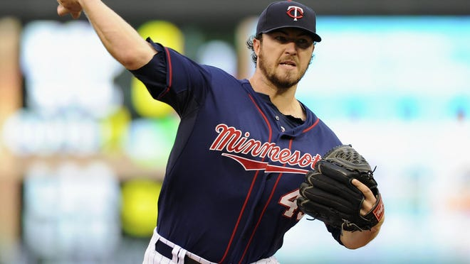 Phil Hughes #45 of the Minnesota Twins delivers a pitch against the San Diego Padres during the second inning of the game on August 5, 2014 at Target Field in Minneapolis, Minnesota.