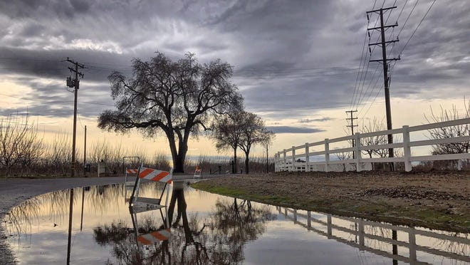 Portions of Visalia flooded after rain poured Saturday and Sunday.