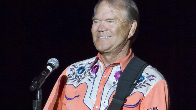 Glen Campbell performsg during his Goodbye Tour in Little Rock. Campbell died this year, six years after announcing he had been diagnosed with Alzheimer's disease.