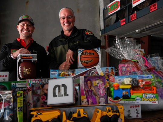 Pastor Dale Robble, left and Sheriff Daron Hall pose for a portrait inside the Last Minute Toy Store in Nashville, Tenn., Thursday, Dec. 7, 2017.