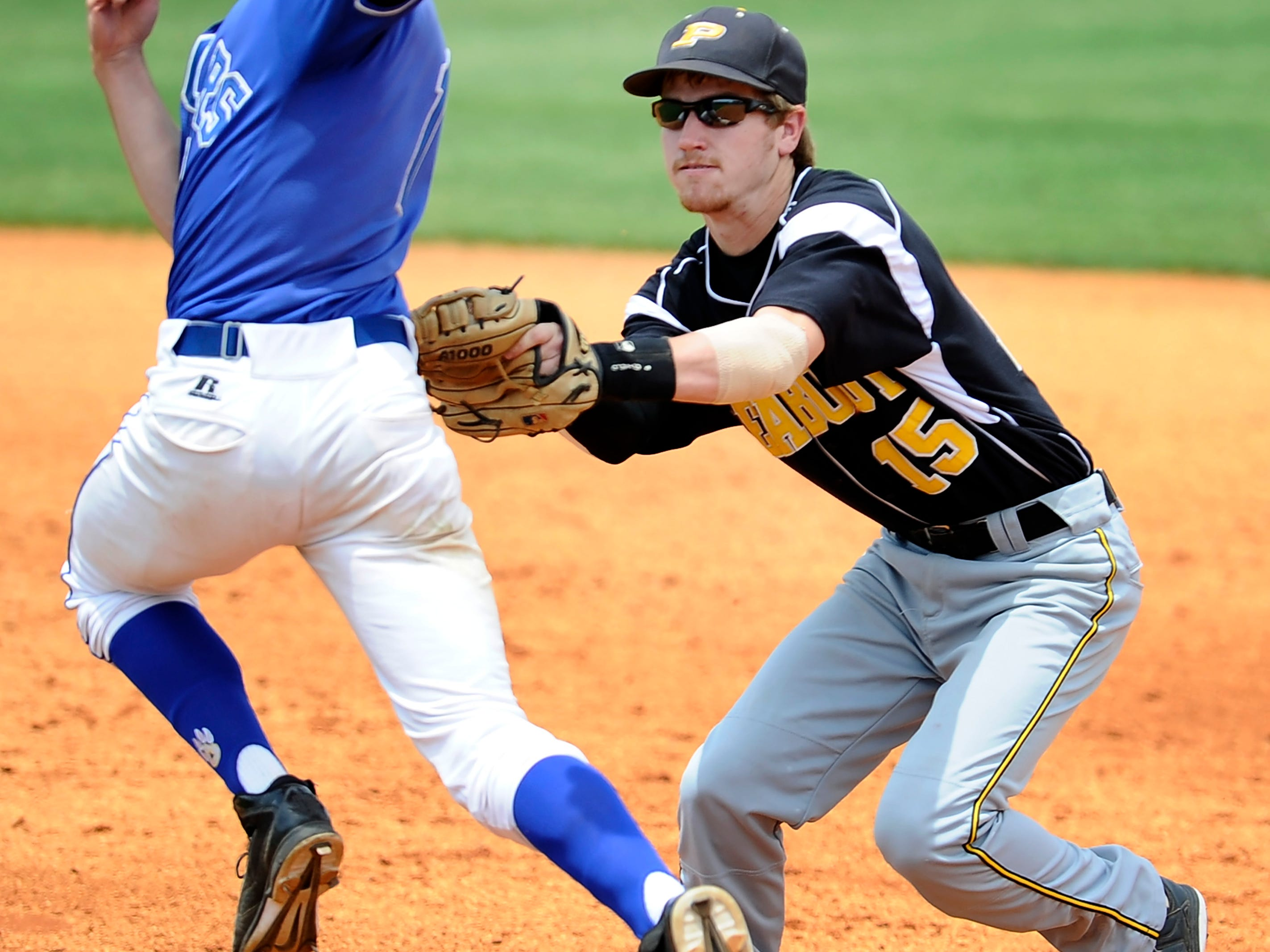 Goodpasture's Jacob Crocker (1) is tagged out by Peabody second baseman Daniel Hodges (15) as Crocker tries to take second base on Wednesday.