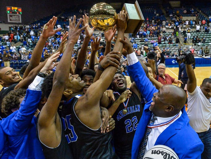 Meridian celebrates winning the 6A state championship