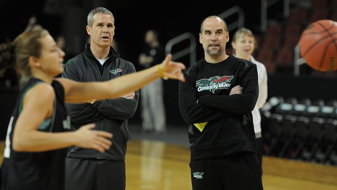 Associate head coach Mike Divilbiss, left, and head coach Matt Bollant oversee a UW-Green Bay women's basketball practice session in March 2011.