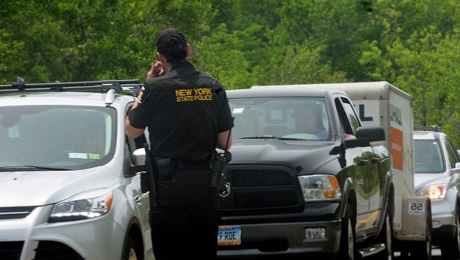 Law enforcement officers search for two escaped prisoners on June 7, 2015, near Dannemora, N.Y.