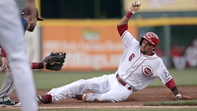 Reds center fielder Billy Hamilton slides in safely as he steals third base during the bottom of the second inning.