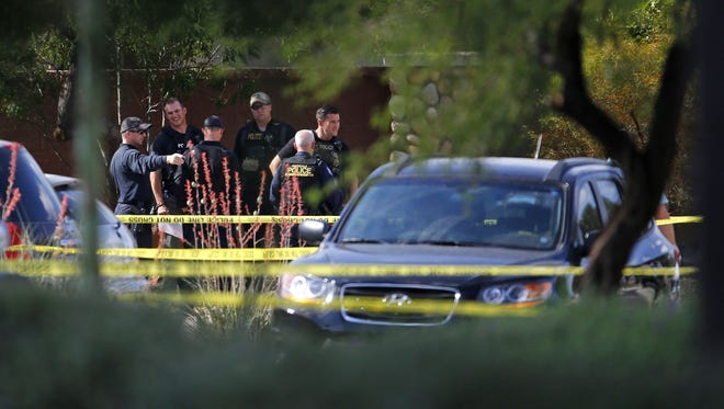 Phoenix police investigate an officer-involved shooting in the 7700 block of 48th Lane just south of Baseline on May 18, 2016, in Phoenix.