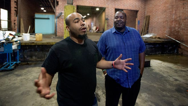 Jonathon Peterson, left, and Charles Lee give a tour of the future home of That's My Child, a community center for kids in Montgomery, Ala., on Friday March 10, 2017. The Black to the Future fundraiser will raise money for the facility.