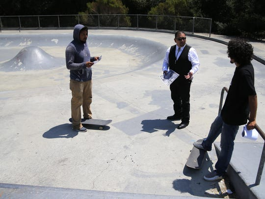 Rail Damian Tapia, MILPA strategic partnership and public relations director, speaks to skaters about the Grind for Equity Skateboarding Jam at the Natividad Creek Skate Park in Salinas.
