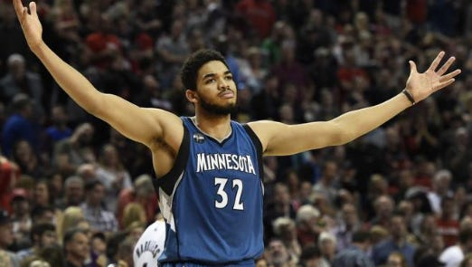 In this April 9, 2016, file photo, Minnesota Timberwolves center Karl-Anthony Towns celebrates after hitting the game-winning shot in an NBA basketball game against the Portland Trail Blazers in Portland, Ore. Towns is the unanimous winner of the NBA Rookie of the Year award.