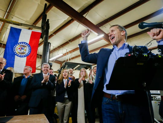 Missouri Gov. Eric Greitens cheers on a crowd after