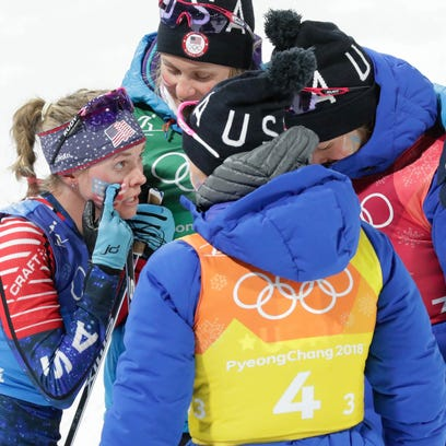 Jessica Diggins (USA) reacts with teammates during