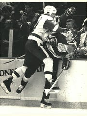 Bob Probert slams into a Los Angeles Kings player on March 1, 1987.