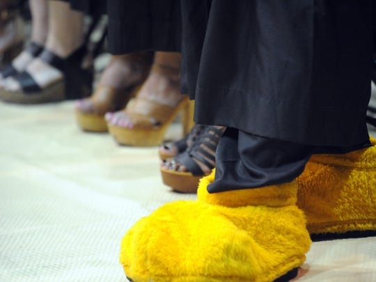 A Southern Miss graduate wears his Seymour feet during