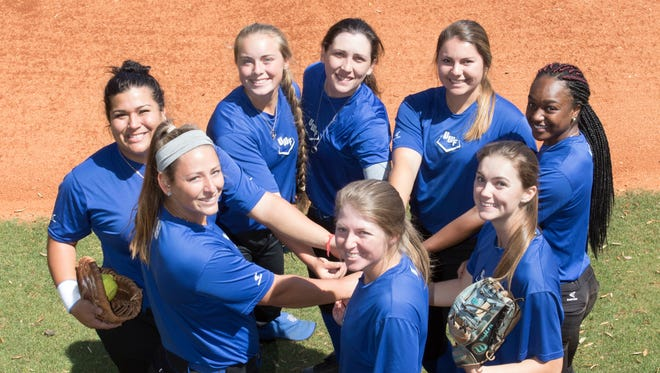 Harley Tagert (1), clockwise from front center, Olivia Printiss (16), Kathleen Smiley (22), Tori Perkins (20), Sara Spears (25), Callan Taylor (10), Jibrasha Moore (12), and Rachel Wright (14) pose on the softball field at the University of West Florida on Thursday, April 5, 2018.  All of these players are Pensacola area homegrown talent.