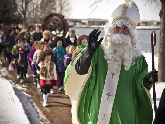 St. Patrick leads the procession downtown Green Bay