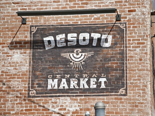 The exterior signage of DeSoto Central Market in downtown