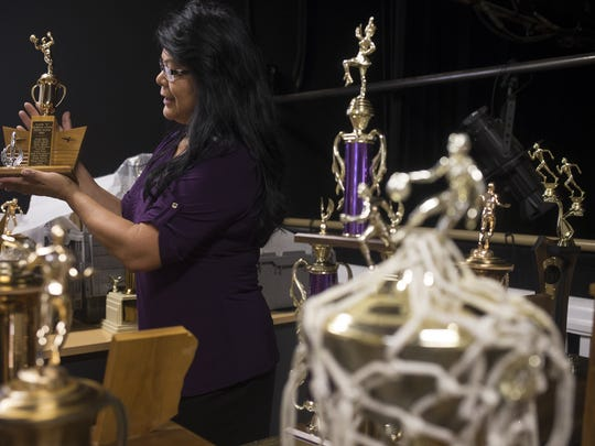 Patty Talahongva holds a trophy that will be on display in the new gallery at the Phoenix Indian School Visitor Center, October 10, 2017, at Steele Indian School Park, 300 E Indian School Road, Phoenix.