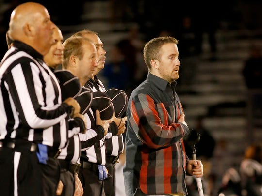 Will Condon places his hand over his heart while the national anthem is sung Oct. 14 at the beginning of the Corning vs. Elmira football game at Corning Memorial Stadium. Corning's football program raised more than $5,000 to help with the costs of Condon's medical care.