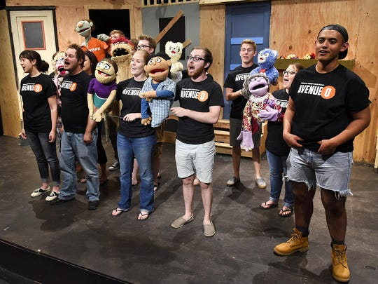 """Members of the Curtain Call Community Theater rehearse their production of """"Avenue Q"""" June 30 at the Pioneer Place on Fifth."""