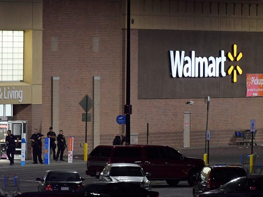 Police guard the front entrance to Walmart where a