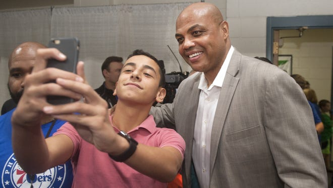 Ryan Bloom, 13 of Cherry Hill, takes a selfie with Charles Barkley, a former Philadelphia 76ers player and NBA Hall of Famer, shortly after Barkley arrived to the Katz JCC Sports Award Dinner in Cherry Hill on Monday evening.  Barkley was the keynote speaker of the event.