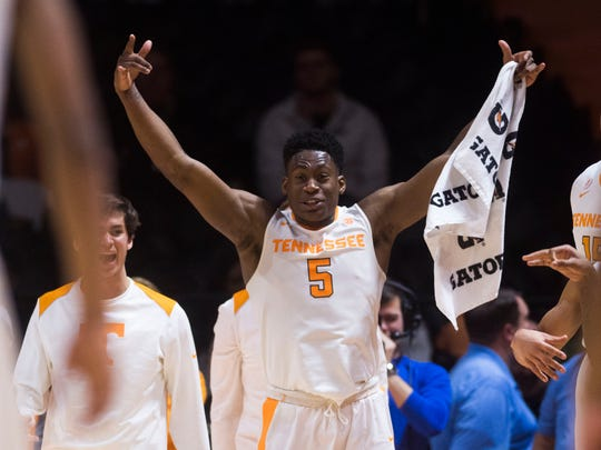 Tennessee forward Admiral Schofield (5) celebrates a teammate's three point shot during a basketball game between University of Tennessee and Ole Miss at Thompson-Boling Arena Saturday, Feb. 3, 2018. Tennessee defeated Ole Miss 94 to 61.