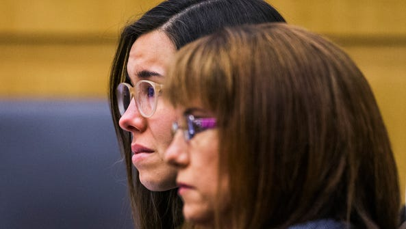 Jodi Arias looks at the jury as Judge Sherry Stephens