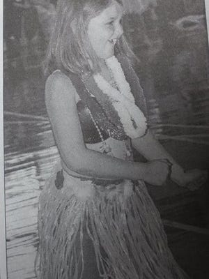 Third grade students of Fran Crawford at Uniontown Elementary celebrated Hawaiian Day on a Friday morning in October of 2004. Pictured is Lani Glazebrook, teaching a proper hula dance step.