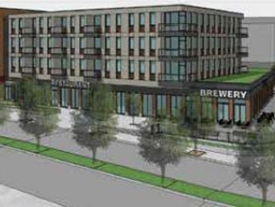 A concept rendering of a four-story mixed used building