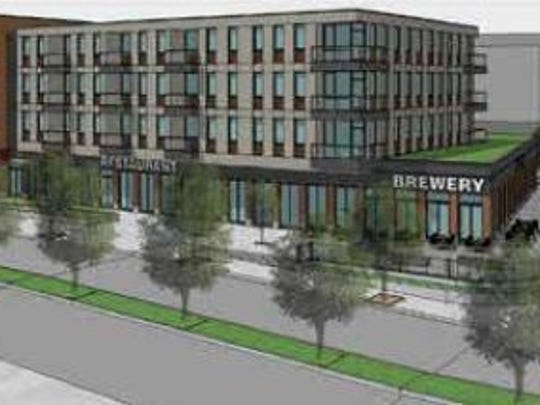 A concept rendering of a four-story mixed used building proposed for an empty site on West Water Street in Elmira.