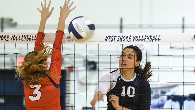 Giao Huynh of West Shore drives the ball past the block of Cocoa Beach's Shannon Greenwell during Tuesday's match in Melbourne.
