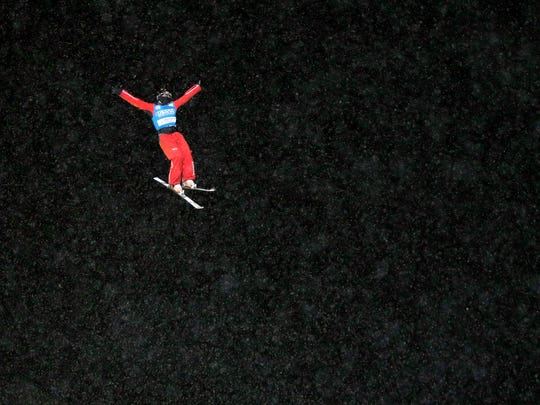 Xu Mengtao, of China, competes in the women's freestyle World Cup aerials competition on Saturday, Jan. 18, 2014, in Lake Placid, N.Y.