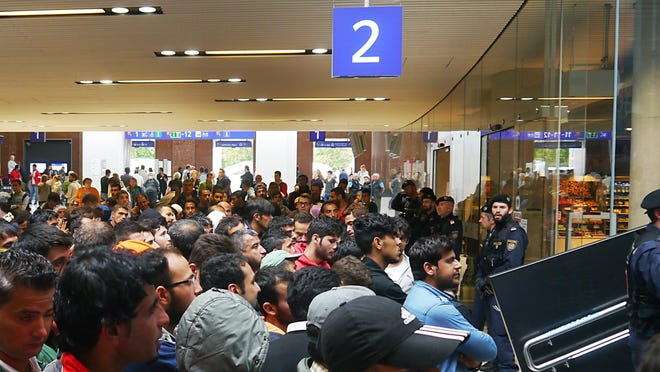 Hundreds of refugees wait in the Salzburg station for a train to Munich, Germany.