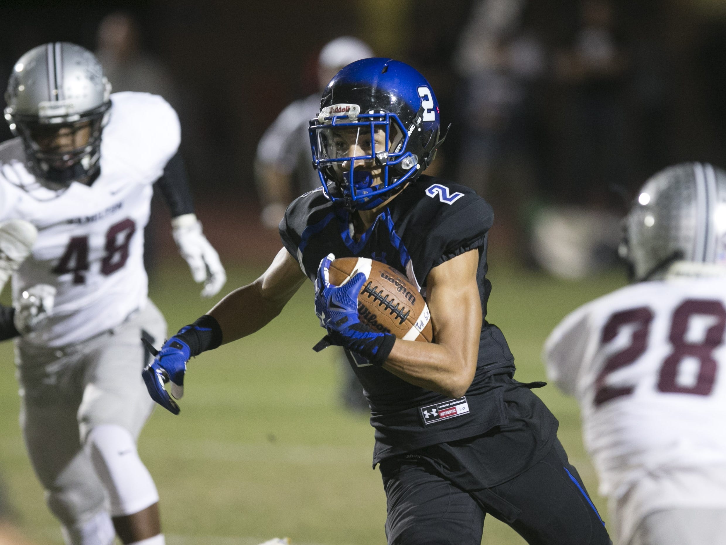 Chandler High running back Chase Lucas carries the ball against Hamilton High during the first half of the high school football game at Chandler High School in Chandler on Friday, October 30, 2015.