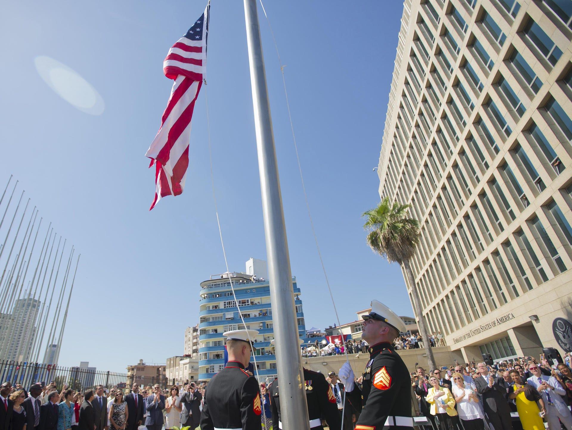 Members of the U.S. Marine Corps raise the U.S. flag