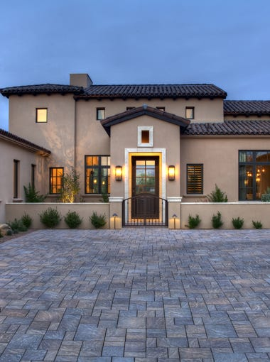 The Reid residence at the foothills of the Superstition Mountains is inside a peaceful gated community with a large golf course.