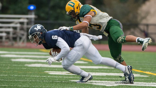 Lebanon Valley College's Michael Gaval is hit by Delaware Valley's Sammy Mohr after a catch during LVC's 48-0 loss at Arnold Field on Saturday.