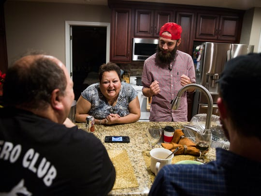 Brice Foutch shows a cellphone video to Kathy Good; her husband, Greg; and friend Wade Morris in Granite Falls, North Carolina, on Thursday, Dec. 1, 2016. Good and Foutch immediately bonded over their sense of humor.