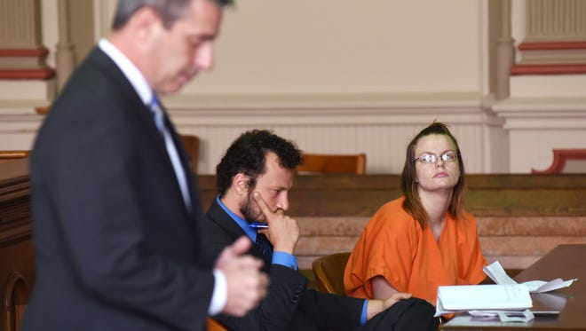 Lori Henry and her attorney Adam Grosshandler listen as Assistant Muskingum County Prosecutor Ron Welch reads the charges against Henry on Monday.