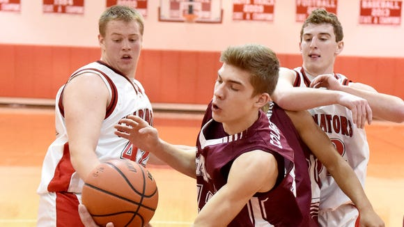 Stuarts Draft's Gage Frazier beats Riverheads' Kendall Casto and John Agnor to the ball in a battle for the rebound during a basketball game played in Greenville on Thursday, Jan. 15, 2015.