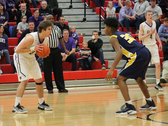 Elder senior Shaun Sullivan dials in on Walnut Hills freshman Nick Smith March 3 in the DI sectional final at Lakota West.