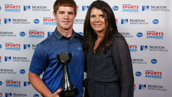Two-time U.S. Olympic gold medalist Mia Hamm, right, posed with Brandon Flora during the CJ Sports Awards.