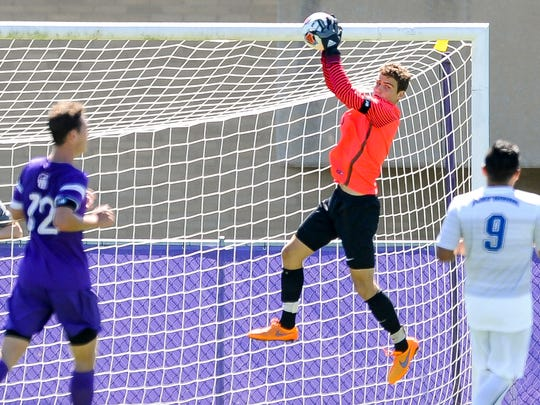 University of Evansville's Matthew Keller (0) blocks a shot during the ProRehab Aces Soccer Classic against Fort Wayne at Arad McCutchan Stadium, Sunday, Sept. 11, 2016. UE beat Fort Wayne 3-1.